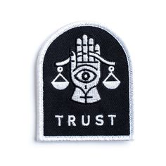 An embroidered jacket patch. White embroidery on woven black panel with custom merrowed edge. This patch is sew-on only. It doesn't have that...