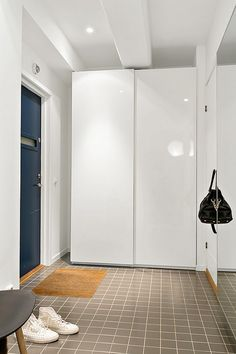 Check Out This Attractive Apartment With Industrial Touches In Central Sweden : Bathroom Design Black Tile Floor White Wall Mirror Blue Door