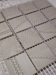 textured tiles drying on a plastic rack by Gary Jackson : Fire When Ready Pottery