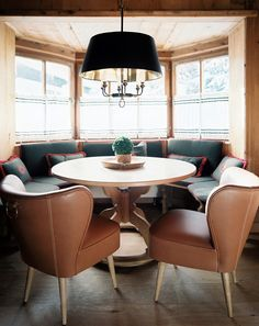 Modern Rustic Furniture: A dining space with leather chairs and a banquette set in a bay window. Banquette Dining, Dining Nook, Round Dining Table, Dining Room Table, Dining Chairs, Corner Banquette, Dining Sets, Lounge Chairs, Modern Rustic Furniture