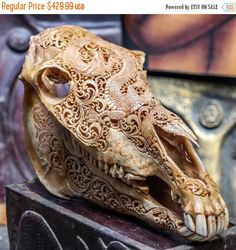 Beautifully Hand Carved Horse Skull Artwork    The Perfect Home, Office, Patio, or Bar Decoration. This Is a Real Skull & Real Horns - Not an Imitation.   About Us:    This Authentic Horse Skull is hand carved by Balinese Master Artisan Carvers. It takes our Master carvers days to complete this One-Of-A-Kind Mystic Dragon design (as shown above). Every Skull imported from Java is slightly different because no two Skulls are the same. The hand carving also differs by each individual artists…