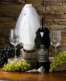 To Have and Hold-  Somethings are meant to go together. Our bride and groom inspired basket features a bottle of our award winning Pinnacle Meritage red wine in a tuxedo groom cover. The bridal match covers a bottle of 2009 Chardonnay. The basket is completed by a duo of two-toned Childress Vineyards wine glasses with the full logo and topped off with a diamond bottle stopper.  Price: $58.95
