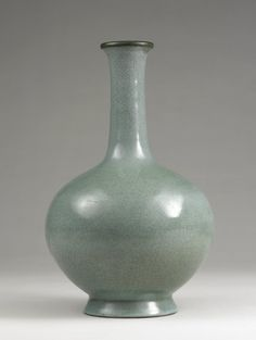 Ru stoneware bottle with globular body, long neck, flaring mouthrim, and high splayed foot. The vase has a copper bound mouthrim, and thick, greyish lavender glaze with greenish tones, and a fine crackle stained grey in places. Northern Song Dynasty Ru Ware.   © The Trustees of the British Museum