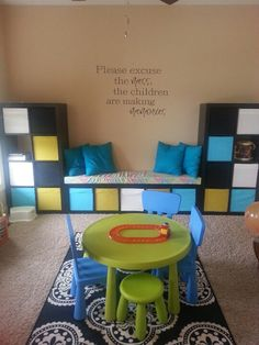 Children's Playroom.....love the quote and storage!