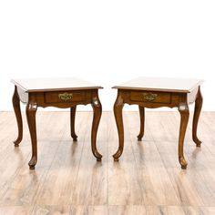 This pair of end tables is featured in a solid wood with a glossy mahogany finish. Each Queen Anne style side table has cabriole legs, a single spacious drawer, and carved trim. Perfect for holding lamps, flowers, and decor! #americantraditional #tables #endtable #sandiegovintage #vintagefurniture