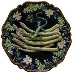 Plate of: Asparagus, Bee and Lizard