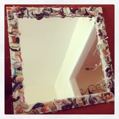 Mirror for an audiology office. Dummy hearing aids glued onto a cheap mirror!