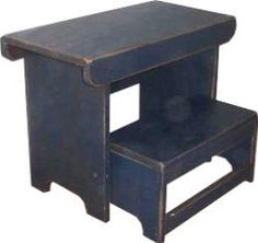 Two-tier folding step stool.  Like the style of this one...in distressed black.  Kids could use at bathroom vanity, kitchen counters, etc...