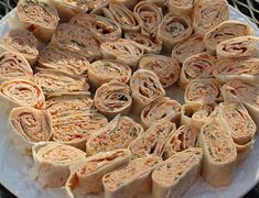 Spicy Chicken Tortilla Roll-Ups...Oh, my gosh, these were GOOD!! So much better than the run-of-the-mill tortilla roll ups I'd been making!