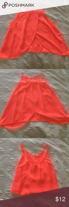 Neon coral open back top Bought from Nordstrom! It is a pinky/coral neon color. Has an open back but stays closed for the most part. Super comfortable- worn once Lush Tops