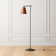 """Shop Reynold Floor Lamp.  Designer Brett Beldock describes this leather floor lamp as """"timeless, handsome and simple. """" Drawing on modernist French art deco inspiration, the metal base angles to a leather shade that's just as at home in a study as it is in the living room or bedroom."""