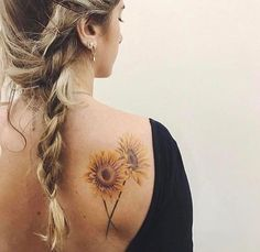 Always wanted a sunflower, and I have no tattoos you can see from the back.  I really, really like this one.