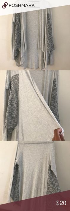Grey Cotton Loose-fit Sporty Sweater Super comfortable vest-inspired lose T-shirt sweater. A perfect staple and flattering for all body types. Runs oversized and lose. Perfect over yoga wear or jeans & Tshirt! Sweaters Shrugs & Ponchos