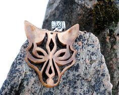 Wooden wolf face pendant. Tribal style. Handmade from Norway.