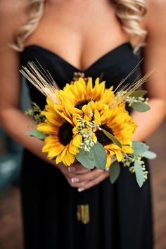 Sunflower bouquets go great with dark bridesmaid dresses
