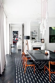The herringbone floor, the carpet, and those hanging fish lamps as a whimsical chandelier have me smiling!