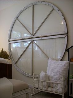 Unique arched windows used together to create a round window used as wall art!