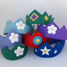 Wool felt crowns from Dream Child Studio are soft and comfy enough to wear all day! They make a sweet birthday tradition or a fun addition to the dress-up box. I make each one by hand in my home studio with heart and soul in every stitch. About this crown: -Colors are emerald green with lightening and stars in white. -Sewn from soft wool and wool blend felt. -Super stretchy, so one size fits most, toddler through adult. (Fits from 18-25 inches around, or 46-64 cm around.) -Measures about 2.5…