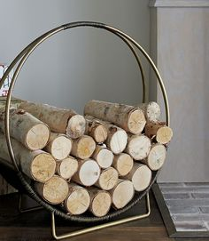 """""""If you're lucky enough to have a fireplace, grab a natural seagrass basket and use it for storing firewood,"""" says Wheeler. """"This adds texture while keeping things tidy and convenient for cool fall evenings."""" We're also loving this antique brass finish log holder ($129, crateandbarrel.com). NEXT: Tour This North Carolina Home Decorated for Fall - CountryLiving.com"""
