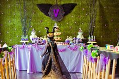Party details to L♥VE about this Maleficent themed birthday party ...♥ Stunning Maleficent part backdrop ♥ Violet candy apples ♥ Maleficent horn cupcakes ♥ Maleficent themed party chair decorations ♥ Maleficent birthday cake and more! ♥