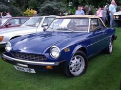 This wasn't mine, but in 1976, my dream car was a blue fiat spyder. I think my top was black, but I loved that car!