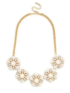 A contemporary take on the '60s daisy print, this necklace evokes a subtly vintage vibe with sweet flowers fashioned from opaque, pastel petals.