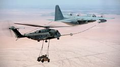 This Is A Plane That's Refueling A Helicopter That's Carrying A Hummer