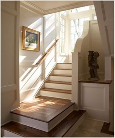 architecture!  beautiful stairway with paneled walls and natural light.