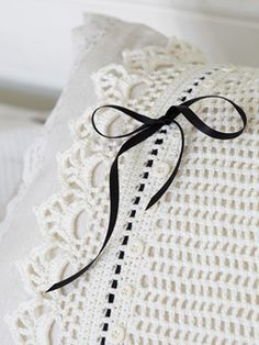 Crochet this beautiful pillowcase from Homespun Vintage. A design by Jane Crowfoot using Siena 4 ply, a beautiful fine mercerised yarn (cotton), this cushion has a simple mesh-stitch pattern, lacy edging, a contrasting narrow ribbon and vintage buttons Crochet Pillows, Knit Pillow, Love Crochet, Knit Crochet, Beautiful Crochet, Crochet Home Decor, Linens And Lace, Crochet Projects, Crochet Patterns
