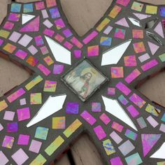 Hand made stained glass mosiac cross with iridescent glass, mirror and soldered image of Jesus in the center