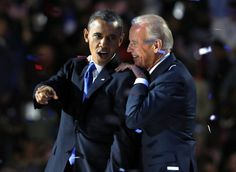 President Barack Obama gestures with Vice President Joe Biden after his election night victory speech in Chicago, November 6,…
