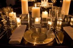 A mix of round and rectangular clear Lucite tables formed the dinner setup in the atrium. The sleek look was matched by clear chargers and ghost chairs;  clusters of pillar candles replaced flowers as centerpieces.