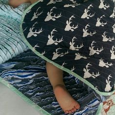 Sleeping boy, wrapped up in MyMinkyMoo Toddler Quilt ❤