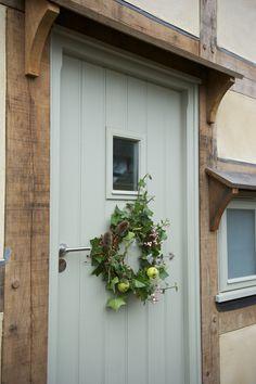 Border Oak - oak framed cottage with wreath.