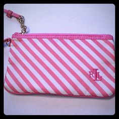 "Ralph Lauren Pink and White Wristlet Like new pink and white striped Ralph Lauren wristlet. There is a small zipped pocket on the inner lining that has the Lauren label. It measures 7.5"" wide and is 4.4"" tall. Ralph Lauren Bags Clutches & Wristlets"