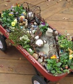 Cool fairy garden using an old radio flyer wagon