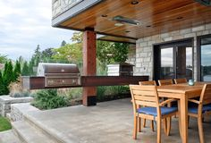 Patio built in grill patio contemporary with outdoor wood table stone wall
