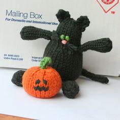 Black #Halloween cat and #knit pumpkin.