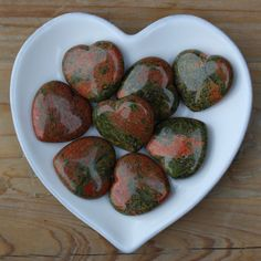 Unakite is said to be the Stone Of Couples. It is associated with Harmonious Relationships and Enduring Love. A wonderful stone to have in your home or to give as a gift. Unakite is a mixture of earthy greens and oranges. We have used Unakite on our Wedding card and you can team them up if you are buying this heart as a wedding gift, but is a lovely stone to support any happy union. Each heart is approximately 3.5 cms in diameter. As this is a natural product, each heart will vary slightly…
