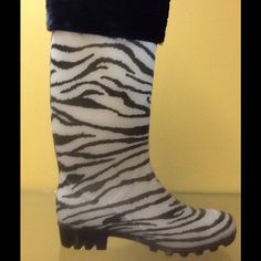 Zebra Print Rain Boot Love animal prints? Then these Zebra print rain boots are just the thing for you! Black and white zebra print, unlined rain boot with faux fur topper - perfect for that rainy day. Must have for the animal print lover. Shaboom by Hypard Shoes Winter & Rain Boots