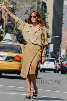 《Vogue》Turkey editor Ece Sukan - black rock'n'roll sandals + earthy camel colours