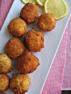 Artichoke & Asiago Poppers ...I never fry anything...but I may have to make just ONE exception.      Recipe:  You take a scoop of chilled artichoke dip and shape into balls.  Dip into flour and egg mixture..then roll into panko.  Fry until browned and serve with lemon.  Enjoy :  )