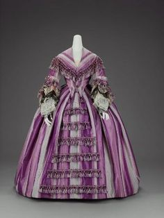 Woman's dress in two parts  American, about 1856–58    Silk plain weave ( taffeta), trimmed with silk fringe tassels, machine embroidered net, and bobbin lace