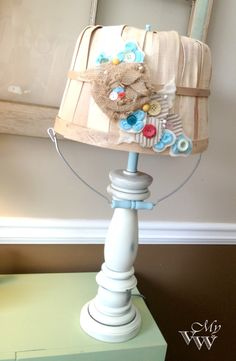 basket lampshade with buttons.... LOVE