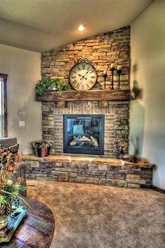 Stone and brick fireplace. This would look awesome in the corner of the living… …