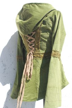 olive green and brown laceup corset  jacket  with a big hoodie and lace details. €155.00, via Etsy.