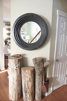 Tree trunks with some branch stumps left on for hanging stuff used as a table in this entry - but I do think I want to paint them white like the others pictured at www.thenester.com.  This chick has some awesome ideas!!!