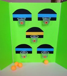 The complete ping pong basketball game made with recycled pudding cups.: