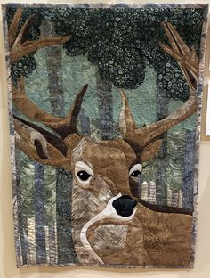 """Wall Quilt 23, """"Oh My Deer!"""" by Christy Gregg  """"When I saw this pattern, I knew I had to make it for my husband who is an avid outdoorsman and deer hunter. I kept it a secret while making it and surprised him with it when he came home from a hunting trip yet again empty handed. It now hangs in our living room. A win/win for both of us. I get another quilt hung on the wall and he gets a deer made by his 'Dear.'"""" Capital City, Empty, Deer, Hunting, Moose Art, Husband, Quilts, Living Room, Wall"""