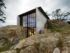 Concrete house by Olson Kundig Architects cuts into a rocky o. Concrete house by Olson Kundig Architects cuts into a rocky outcrop Architecture Design, Residential Architecture, Contemporary Architecture, Amazing Architecture, Concrete Architecture, Dezeen Architecture, Architecture Awards, Seattle Architecture, Architecture Interiors